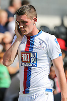 Connor Dymond of Crystal Palace leaves the field with a cut eye during the Friendly match between Barnet and Crystal Palace at The Hive, London, England on 11 July 2015. Photo by David Horn.
