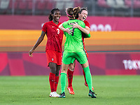 KASHIMA, JAPAN - AUGUST 2: Kadeisha Buchanan #3 and Allysha Chapman #2 of Canada celebrate with Stephanie Labbe #1 after a game between Canada and USWNT at Kashima Soccer Stadium on August 2, 2021 in Kashima, Japan.