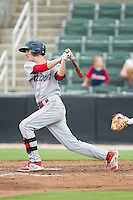 Carlos Tocci (15) of the Lakewood BlueClaws follows through on his swing against the Kannapolis Intimidators at CMC-NorthEast Stadium on July 20, 2014 in Kannapolis, North Carolina.  The Intimidators defeated the BlueClaws 7-6. (Brian Westerholt/Four Seam Images)