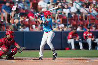 Spokane Indians third baseman Diosbel Arias (21) at bat in front of catcher Yorman Rodriguez (13) during a Northwest League game against the Vancouver Canadians at Avista Stadium on September 2, 2018 in Spokane, Washington. The Spokane Indians defeated the Vancouver Canadians by a score of 3-1. (Zachary Lucy/Four Seam Images)