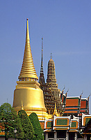 Wat Phra Keo, or Emerald Buddha or Royal Palace, Bangkok, Thailand.  Three main stupas in a variety of styles seen from outside the temple..