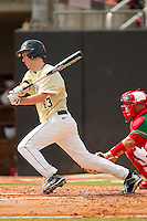 Grant Shambley #43 of the Wake Forest Demon Deacons follows through on his swing against the North Carolina State Wolfpack at Doak Field at Dail Park on March 17, 2012 in Raleigh, North Carolina.  The Wolfpack defeated the Demon Deacons 6-2.  (Brian Westerholt/Four Seam Images)