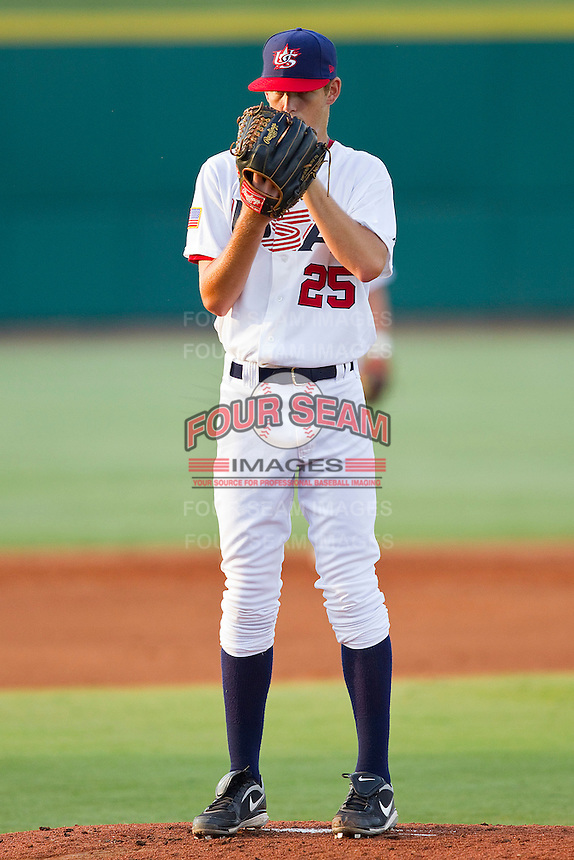 Cole Irvin #25 of the USA 18u National Team looks to his catcher for the sign against the USA Baseball Collegiate National Team at the USA Baseball National Training Center on July 2, 2011 in Cary, North Carolina.  The College National Team defeated the 18u team 8-1.  Brian Westerholt / Four Seam Images