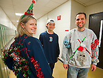 SOUTHBURY,  CT-122316JS04--Teacher, and last years winner, Liz Burgess, left, with Art Blais, right, show off their sweaters that were made with the help of student Jack Rafferty, 16, center, during the annual Region 15 Best Sweater  Contest fundraiser Friday at Pomperaug High School in Southbury. Money raised from the event will go to the Victoria Soto Memorial Fund, honoring a Sandy Hook Teacher who died trying to protect children from the shooter. In early voting, it was looking like Blais would be this years winner. Jim Shannon Republican American