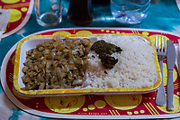 """Senegal.  Lunch in a Diourbel Restaurant.  """"C'est Bon"""" is a Casamance dish consisting of rice, fish, onions, and spinach."""