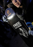 A girl holds a skateboard with a picture of Liu Xiaobo..The Norwegian Nobel Committee decided to award the Nobel Peace Prize for 2010 to Liu Xiaobo. In a press conference in Oslo on Dec 9 , 2010, Director Geir Lundestad (left) and leader of the Norwegian Nobel Committee Thorbjørn Jagland elaborated on their decision to award the prize to Xiaobo...Representatives from the Embassy of the People's Republic of China in Oslo would not meet activists from many countries later that afternoon when they, together with Amnesty International, tried to hand over nearly 100.000 signatures in support of the release of the Nobel Peace Prize Laureate Liu Xiaobo. ..Photo: Fredrik Naumann/Felix Features
