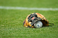 A baseball and glove sit on the field prior to the South Atlantic League game between the Greenville Drive and the Kannapolis Intimidators at CMC-Northeast Stadium on June 30, 2013 in Kannapolis, North Carolina.  The Drive defeated the Intimidators 3-0.   (Brian Westerholt/Four Seam Images)