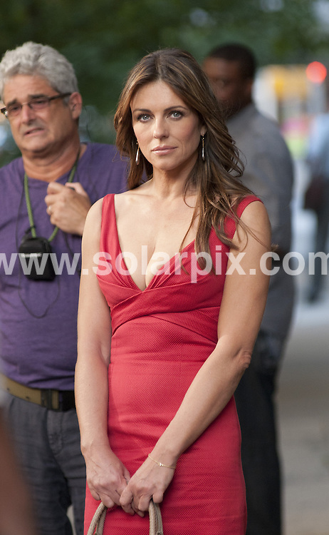 **ALL ROUND PICTURES FROM SOLARPIX.COM**                                             **SYNDICATION RIGHTS FOR UK, AUSTRALIA, DENMARK, PORTUGAL, S. AFRICA, SPAIN & DUBAI (U.A.E) & ASIA (EXCLUDING JAPAN) ONLY**                                                                                  Caption: Gossip Girl Filming on the Upper East Side in New York City, NY, USA. July 13, 2011                                                                              This pic: Elizabeth Hurley                                                                                             JOB REF: 13707 PHZ Mayer      DATE: 13_07_2011                                                            **MUST CREDIT SOLARPIX.COM OR DOUBLE FEE WILL BE CHARGED**                                                                      **MUST AGREE FEE BEFORE ONLINE USAGE**                               **CALL US ON: +34 952 811 768 or LOW RATE FROM UK 0844 617 7637**