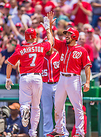 31 May 2014: Washington Nationals infielder Anthony Rendon greets Scott Hairston at home plate after scoring on Hairston's homer in the 6th inning against the Texas Rangers at Nationals Park in Washington, DC. The Nationals defeated the Rangers 10-2, notching a second win of their 3-game inter-league series. Mandatory Credit: Ed Wolfstein Photo *** RAW (NEF) Image File Available ***