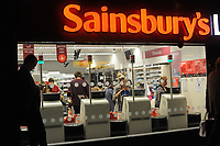 Shoppers at the Clapham branch of Sainsbury Local supermarket at self service tills. London, UK.  Sainsbury is the third largest supermarket in the UK. 18-Sept-2012.