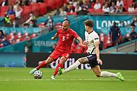 7th July 2021, Wembley Stadium, London, England; 2020 European Football Championships (delayed) semi-final, England versus Denmark;   Martin BRAITHWAITE DEN takes on John STONES ENG