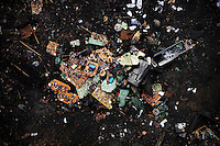 Broken pieces of circuit boards lie in the dirt at Agbogbloshie dump, which has become a dumping ground for computers and electronic waste from all over the developed world. Hundreds of tons of e-waste end up here every month. It is broken apart, and those components that can be sold on, are salvaged.