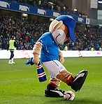 Broxi Bear backheels the ball