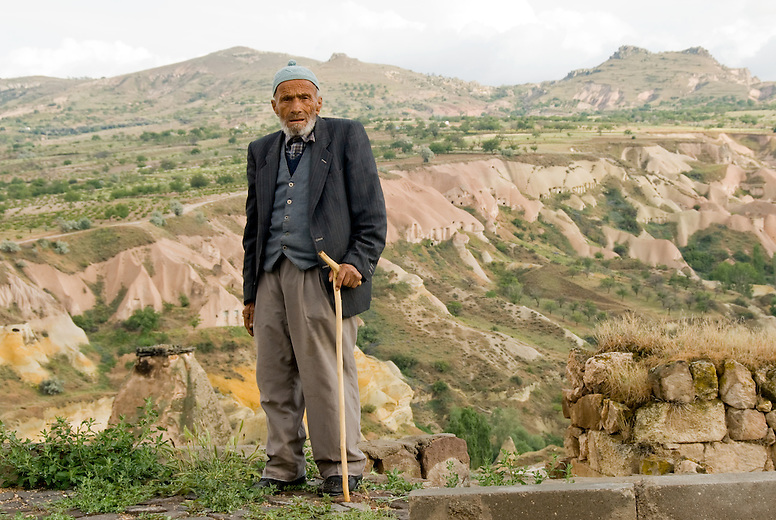 A local man in Uchisar, looking out over the valleys and rock formations in Cappadocia, Turkey.