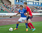 St Johnstone v FC Minsk...01.08.13 Europa League Qualifier at Neman Stadium, Grodno, Belarus...<br /> Stevie May holds off Aliaksei Bialevich<br /> Picture by Graeme Hart.<br /> Copyright Perthshire Picture Agency<br /> Tel: 01738 623350  Mobile: 07990 594431