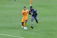 ST PAUL, MN - OCTOBER 18: Kei Kamara #16 of Minnesota United FC and Victor Cabrera #36 of Houston Dynamo battle for the ball during a game between Houston Dynamo and Minnesota United FC at Allianz Field on October 18, 2020 in St Paul, Minnesota.