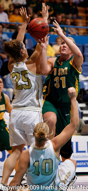 SIOUX FALLS, SD - MARCH 9:  Ashley Samuelson #31 of North Dakota State commits an offensive foul as she charges into Melissa Jeltema #10 of Oakland University during their  semi-final game at the Summit League tournament in Sioux Falls, S.D. Monday.  Also guarding on the play is Anna Patritto #25 of Oakland. (Photo by Dick Carlson/Inertia)