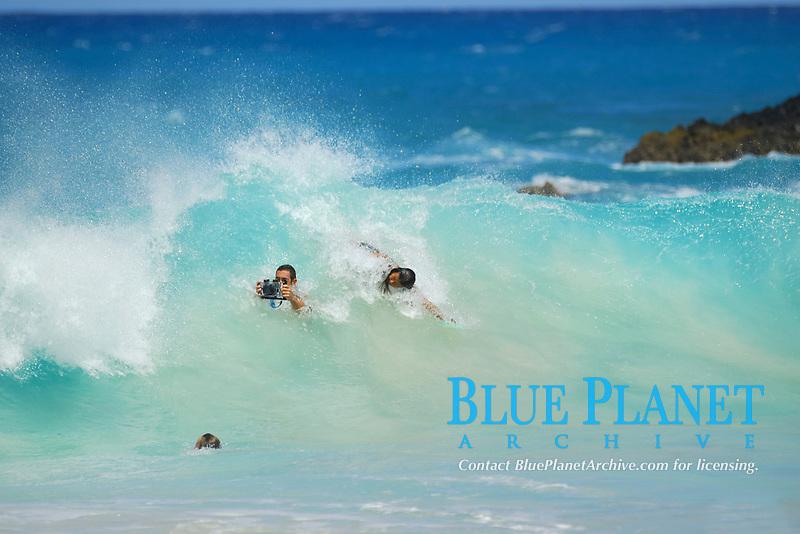 Large barreling wave, guy with camera, bodyboarders and body surfers, Kekaha Kai park, Kua bay, Kailua Kona, The Big Island of Hawaii