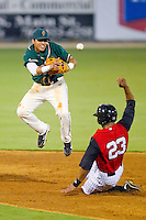 Jose Torres #18 of the Greensboro Grasshoppers fires the ball to first base ahead of the slide by Kyle Colligan #23of the Kannapolis Intimidators at Fieldcrest Cannon Stadium August 2, 2010, in Kannapolis, North Carolina.  Photo by Brian Westerholt / Four Seam Images