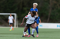 Seattle, WA - Saturday April 15, 2017: Kayla Mills, Megan Rapinoe during a regular season National Women's Soccer League (NWSL) match between the Seattle Reign FC and Sky Blue FC at Memorial Stadium.