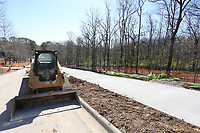 A new sidewalk is visible as infrastructure work continues Thursday, April 1, 2021, on the first phase of the development on Markham Hill near the intersection of Markham Road and Cross Avenue in Fayetteville. Check out nwadg.com/photos for a photo gallery.<br /> (NWA Democrat-Gazette/David Gottschalk)