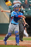 Tennessee Smokies catcher Kyle Schwarber (12) throws to first to complete the strikeout during a game against the Montgomery Biscuits on May 25, 2015 at Riverwalk Stadium in Montgomery, Alabama.  Tennessee defeated Montgomery 6-3 as the game was called after eight innings due to rain.  (Mike Janes/Four Seam Images)