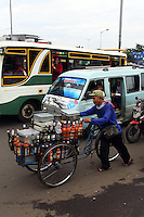 A man pushes his cart selling hot chilli sauce through the busy roads of central Jakarta.<br /> <br /> To license this image, please contact the National Geographic Creative Collection:<br /> <br /> Image ID:  1588033<br />  <br /> Email: natgeocreative@ngs.org<br /> <br /> Telephone: 202 857 7537 / Toll Free 800 434 2244<br /> <br /> National Geographic Creative<br /> 1145 17th St NW, Washington DC 20036