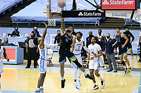 CHAPEL HILL, NC - FEBRUARY 24: Theo John #4 of Marquette shoots a layup during a game between Marquette and North Carolina at Dean E. Smith Center on February 24, 2021 in Chapel Hill, North Carolina.