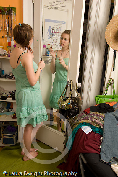 Teenage girl age 15 in room at home