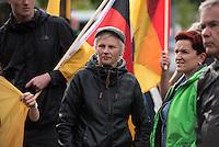 """Knapp 100 Mitglieder und Anhaenger der sog. """"Identitaeren"""" demonstrierten am Freitag den 17. Juni 2016 in Berlin. Angemeldet waren laut Veranstalter 400 Teilnehmer. Die rechtsextremen Teilnehmer des Aufmarsches kamen aus Berlin, Bayern und Oestrreich und skandierten Parolen wie """"Berlin ist unsere Stadt"""", """"Festung Europa, macht die Grenzen dicht"""" und No Border, No Nation, Stop Immigration"""".<br /> Im Bild mit grauer Schiebermuetze: Anne Haberstroh, Vereinsvorsitzende von """"Zukunft Heimat"""" aus<br /> Brandenburg.<br /> 17.6.2016, Berlin<br /> Copyright: Christian-Ditsch.de<br /> [Inhaltsveraendernde Manipulation des Fotos nur nach ausdruecklicher Genehmigung des Fotografen. Vereinbarungen ueber Abtretung von Persoenlichkeitsrechten/Model Release der abgebildeten Person/Personen liegen nicht vor. NO MODEL RELEASE! Nur fuer Redaktionelle Zwecke. Don't publish without copyright Christian-Ditsch.de, Veroeffentlichung nur mit Fotografennennung, sowie gegen Honorar, MwSt. und Beleg. Konto: I N G - D i B a, IBAN DE58500105175400192269, BIC INGDDEFFXXX, Kontakt: post@christian-ditsch.de<br /> Bei der Bearbeitung der Dateiinformationen darf die Urheberkennzeichnung in den EXIF- und  IPTC-Daten nicht entfernt werden, diese sind in digitalen Medien nach §95c UrhG rechtlich geschuetzt. Der Urhebervermerk wird gemaess §13 UrhG verlangt.]"""