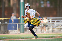 Savannah Bananas Gabe Howell (6) scores a run during a Coastal Plain League game against the Macon Bacon on July 15, 2020 at Grayson Stadium in Savannah, Georgia.  Savannah wore kilts for their St. Patrick's Day in July promotion.  (Mike Janes/Four Seam Images)