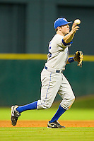 Third baseman Thomas McCarthy #25 of the Kentucky Wildcats makes a throw to first base against the Rice Owls at Minute Maid Park on March 4, 2011 in Houston, Texas.  Photo by Brian Westerholt / Four Seam Images
