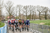 peloton up the Eikenberg with eventual winner Kasper Asgreen (DEN/Deceuninck - Quick Step) still on 'peloton duty' at this point<br /> <br /> 105th Ronde van Vlaanderen 2021 (MEN1.UWT)<br /> <br /> 1 day race from Antwerp to Oudenaarde (BEL/264km) <br /> <br /> ©kramon
