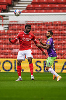 3rd October 2020; City Ground, Nottinghamshire, Midlands, England; English Football League Championship Football, Nottingham Forest versus Bristol City; Loïc Mbe Soh of Nottingham Forest heads the ball clear