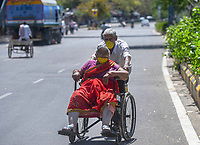 NEW DELHI, INDIA - APRIL 3: An elderly man escorts an elderly woman outside AIIMS hospital on day ten of the 21-day nationwide lockdown to curb the spread of coronavirus on April 3, 2020 in New Delhi, India.  <br /> Photo Imago/Panoramic/Insidefoto