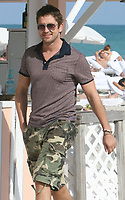 MIAMI BEACH, FL - JANUARY 02:  300 Actor Gerard Butler enjoys a day at the beach with friends.  On January 02,, 2009 in Miami Beach, Florida<br /> <br /> <br /> People:  Gerard Butler
