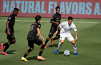 LOS ANGELES, CA - AUGUST 22: Cristian Pavon #10 of the Los Angeles Galaxy moves with the ball past the Los Angeles FC during a game between Los Angeles Galaxy and Los Angeles FC at Banc of California Stadium on August 22, 2020 in Los Angeles, California.