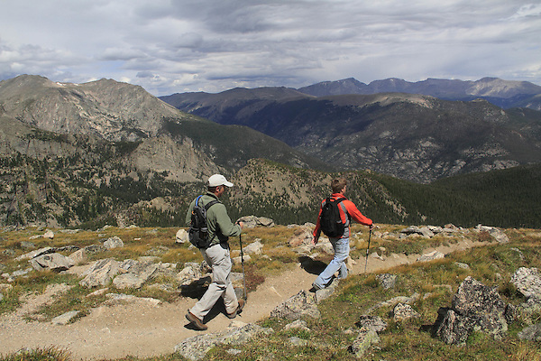 Caucasian father and son hiking the Twin Peaks Trail in Rocky Mountain National Park, west of Estes Park, Colorado. .  John leads hikes and private photo tours in Boulder and throughout Colorado. Year-round.