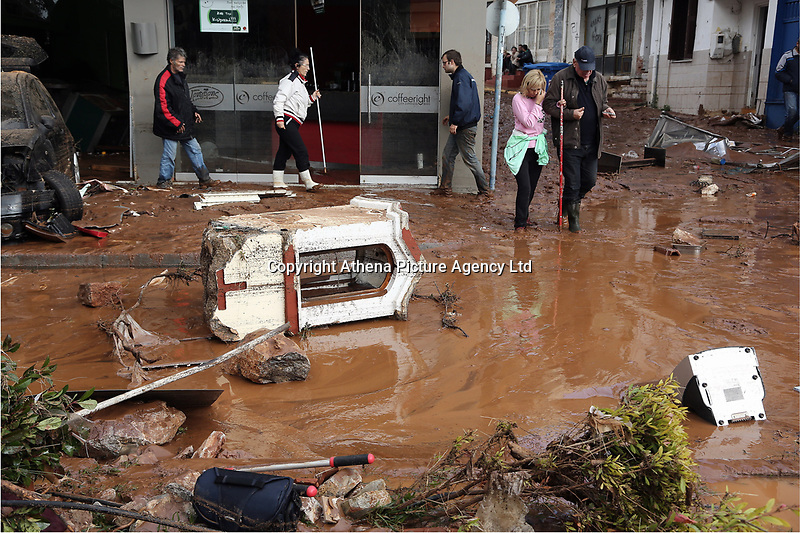 Pictured: Debris and mud on the road.<br /> Re: Five people have reportedly died and severe damage caused by heavy rain and flash flooding in the area of Mandra, near Athens, Greece. Wednesday 15 November 2017