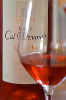 Cuvee Qu'es Aquo rose wine. Domaine Mas Cal Demoura, in Jonquieres village. Terrasses de Larzac. Languedoc. France. Europe. Bottle. Wine glass.