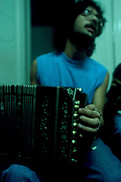 Pablo Ciriberto, 22, plays the bandoneon during a music class at the National Academy of Tango in Buenos Aires, May 2003.