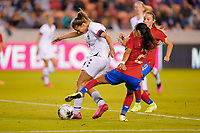 HOUSTON, TX - FEBRUARY 03: Tobin Heath #17 of the Unites States dribbles past Gabriela Guillen #2 of Costa Rica during a game between Costa Rica and USWNT at BBVA Stadium on February 03, 2020 in Houston, Texas.