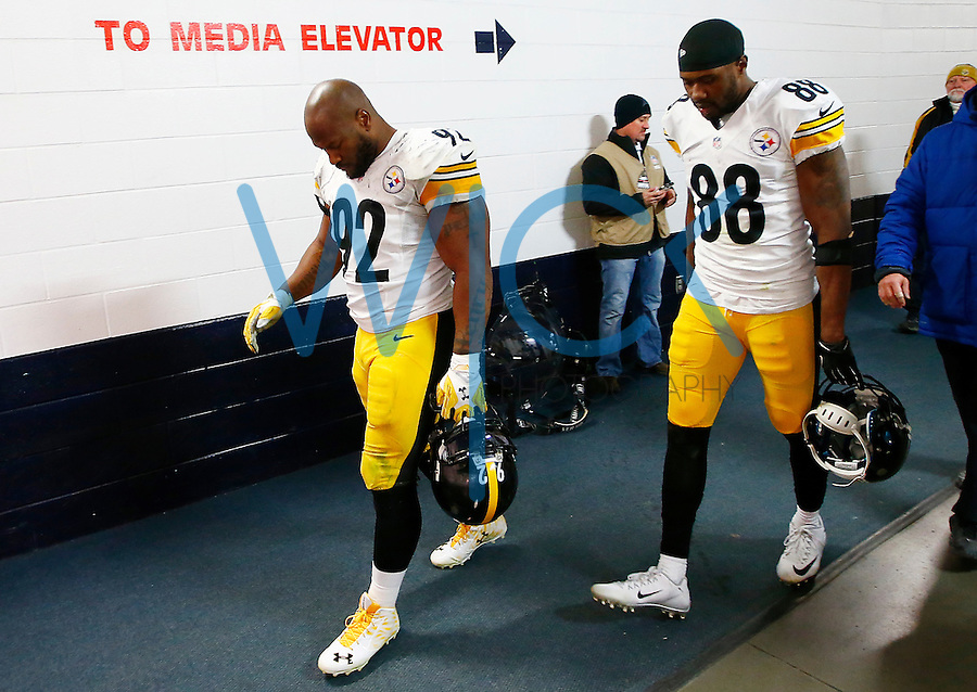 James Harrison #92 and Darrius Heyward-Bey #88 of the Pittsburgh Steelers walk off of the field following their 16-23 loss to the Denver Broncos during the AFC Divisional Round Playoff game at Sports Authority Field at Mile High on January 17, 2016 in Denver, Colorado. (Photo by Jared Wickerham/DKPittsburghSports)