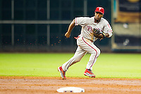 Philadelphia Phillies shortstop Jimmy Rollins #11 on defense during the Major League baseball game against the Houston Astros on September 16th, 2012 at Minute Maid Park in Houston, Texas. The Astros defeated the Phillies 7-6. (Andrew Woolley/Four Seam Images).