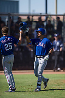 Texas Rangers third baseman Tyler Ratliff (32) is congratulated by Myles McKisic (25) after hitting a home run during an Instructional League game against the San Diego Padres on September 20, 2017 at Peoria Sports Complex in Peoria, Arizona. (Zachary Lucy/Four Seam Images)