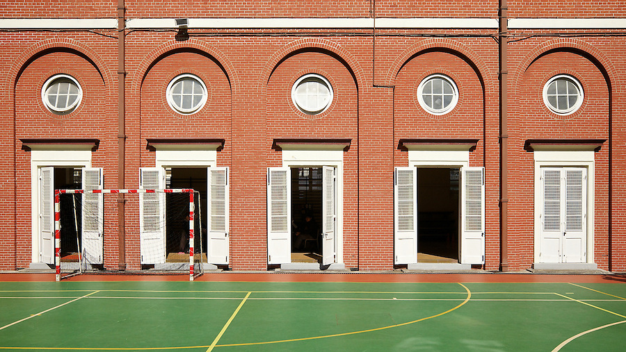 Doors to the Gym open onto the central playground at King's College.