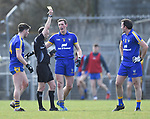 Cathal O Connor of Clare is shown a yellow card by referee Niall Cullen watched by team mates Keelan Sexton and David Tubridy during their National League game at Cusack Park. Photograph by John Kelly.