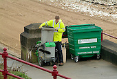 An East Riding Council employee empties rubbish bins in the Yorkshire seaside resort of Bridlington on Easter Bank Holiday.