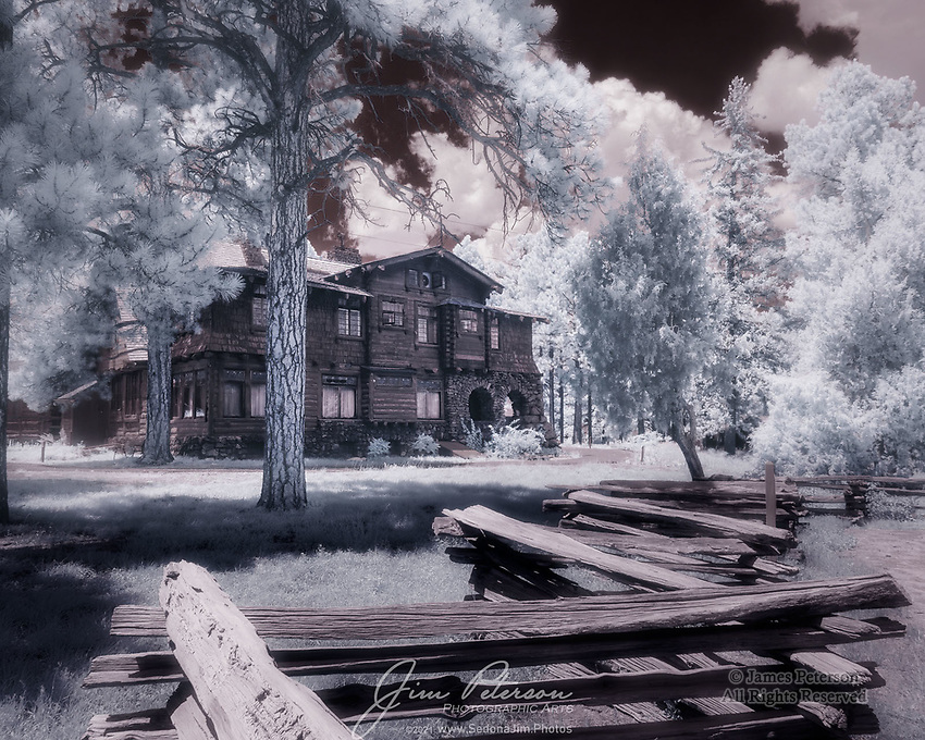 Riordan Mansion, Flagstaff (Infrared).  This 13,000 square foot (i.e., huge!) log structure is now an Arizona State Historic Park.  It actually consists of two adjoining mansions connected by a common room; this image only shows about half of the total building.  It was constructed in 1904 for the two Riordan brothers, lumber magnates who were married to a pair of sisters from the Metz family.  They were all apparently big fans of family togetherness, so they built this double mansion to keep everyone under one roof.  And being lumber barons, they showed off their wares by building it out of logs.<br /> <br /> Tech info: Nikon D3200 camera with Nikon 10-24mm lens at 16mm, 1/250 sec. at f11, ISO 200.<br /> <br /> Image ©2021 James D. Peterson