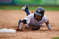 Kane County Cougars Jorge Perez (16) slides into first base on a pickoff attempt during a Midwest League game against the Fort Wayne TinCaps at Parkview Field on May 1, 2019 in Fort Wayne, Indiana. Fort Wayne defeated Kane County 10-4. (Zachary Lucy/Four Seam Images)